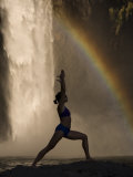 Young Woman Practicing Yoga on a Rock  Snoqualmie Falls  Washington State  USA