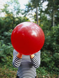 Close-up of a Woman Blowing a Balloon  Germany