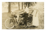 Black and White Photo of Man and Woman by Vintage Motorcycle