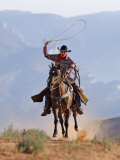 Cowboy Running with Rope Lassoo in Hand  Flitner Ranch  Shell  Wyoming  USA