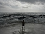 Child Standing at the Edge of Tide
