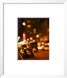Blurred View of Cars and Illuminating Lights and Signs on Busy City Street at Night