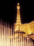 Paris Hotel and Casino's Eiffel Tower with the Bellagio Water Fountain Show  Las Vegas  Nevada  USA