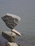 Rocks Balanced by a Man on the Shore of San Francisco Bay  California  USA