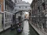 Historic Bridge of Sighs and Gondolas in Canal  Venice  Italy