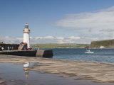 Lighthouse at Entrance to Outer Harbour  Motor Yacht Entering  Whitehaven  Cumbria  England  UK