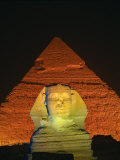 Sphinx and One of the Pyramids Illuminated at Night  Giza  Cairo  Egypt