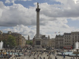 Nelsons Column in Trafalgar Square  with Big Ben in Distance  London  England  United Kingdom
