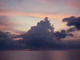 Towering Dark Grey Clouds in a Pink and Blue Sky over the Sea in Malaysia  Southeast Asia