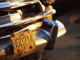 Close-Up of Chrome Bumper and Yellow Car Number Plate in Morning Light  Havana  Cuba