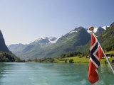 Sailing on the Green Lake and Norwegian Flag  Olden  Fjordland  Norway  Scandinavia  Europe
