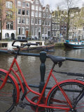 Red Bicycle by the Herengracht Canal  Amsterdam  Netherlands  Europe