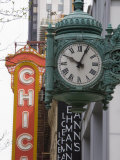 Marshall Field Building Clock and Chicago Theatre Behind  Chicago  Illinois  USA