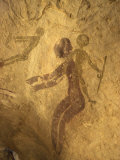 Rock Paintings of Decorated Woman and Children on Cave  Tassili N'Ajjer  Algeria