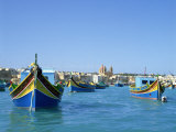 Painted Boats in the Harbour at Marsaxlokk  Malta  Mediterranean  Europe