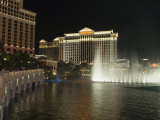 Bellagio Hotel in Forground with Caesar's Palace in Background at Night  Las Vegas  Nevada  USA