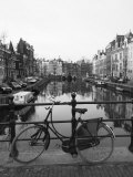 Black and White Image of an Old Bicycle by the Singel Canal  Amsterdam  Netherlands  Europe