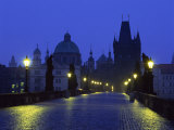 Charles Bridge at Night and City Skyline with Spires  Prague  Czech Republic