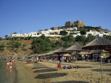 Beach Below the White Houses and Acropolis of Lindos Town  Rhodes  Dodecanese Islands  Greece