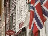 Wooden Merchants Premises and Norwegian Flag  Bryggen Old Harbour Side  Bergen  Norway  Scandinavia