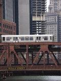 An El Train on the Elevated Train System Crossing Wells Street Bridge  Chicago  Illinois  USA