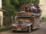 Jeepney Truck with Passengers Crowded on Roof  Coron Town  Busuanga Island  Philippines