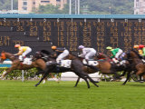 Horses Race Past Large Scoreboard During Race at Happy Valley Racecourse  Hong Kong  China