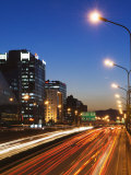 Car Light Trails and Modern Architecture on a City Ring Road  Beijing  China