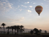 Hot Air Balloons Carry Tourists on Early Morning Flights over the Valley of the Kings  Luxor  Egypt