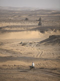 Man on Mule-Back Traverses the Desert around the Ancient City of Old Dongola  Sudan  Africa
