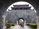 Tourist Rickshaw at a City Gate Watch Tower  Qufu City  Shandong Province  China