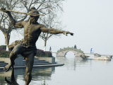 Statue of a Spear Fisherman in the Waters of West Lake  Hangzhou  Zhejiang Province  China