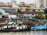 Barges on River Pasig with City Buildings Behind  Manila  Philippines  Southeast Asia
