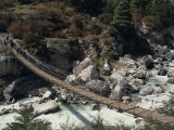 High Angle View of Trekkers Crossing Rope Bridge over a River in Everest Region  Nepal