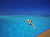 Man Jumping into Tropical Sea from Deck  Maldives  Indian Ocean