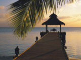 Couple Looking at Sunset on a Jetty  Maldives  Indian Ocean
