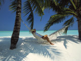 Man Relaxing on a Beachside Hammock  Maldives  Indian Ocean