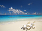 Two Deck Chairs on Tropical Beach Facing Sea  Maldives  Indian Ocean