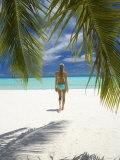 Young Woman Walking on Beach  Maldives  Indian Ocean