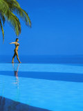 Woman Balancing on Edge of Infinity Pool  Maldives  Indian Ocean