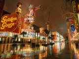 Night Reflections on Wet Street of Neon Signs Along Fremont Street in Las Vegas  Nevada  USA