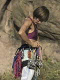 Female Rock Climber Preparing Her Equipment