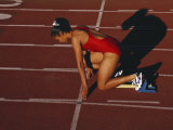 Female Runner at the Start of a Track Race