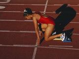 Female Runner at the Start of a Track Race