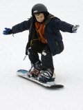 9 Year Old Boy Riding His Snowboard  New York  USA
