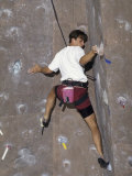 Man Wall Climbing Indoors with Equipment