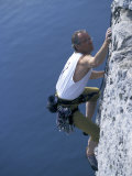 Male Rock Climber Reaching for a Grip