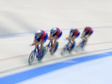 Cycling Team Competing on the Velodrome