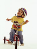 4 Year Old Boy Posing on His Tricycle  New York  New York  USA