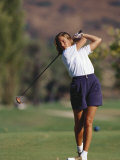 Woman Golfer in Action